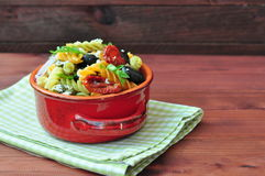 Pasta salad with dried tomatoes, truffle oil and parmesan cheese Stock Photos