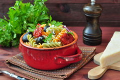 Pasta salad with dried tomatoes, truffle oil and parmesan cheese Stock Images