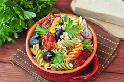 Pasta salad with dried tomatoes, truffle oil and parmesan cheese Stock Photography