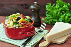 Pasta salad with dried tomatoes, truffle oil and parmesan cheese Stock Photo