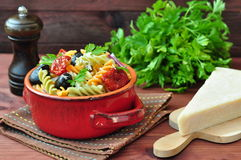 Pasta salad with dried tomatoes, truffle oil and parmesan cheese Royalty Free Stock Images