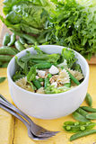 Pasta salad with farfalle, peas and feta Stock Image