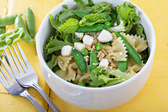 Pasta salad with farfalle, peas and feta Royalty Free Stock Photos