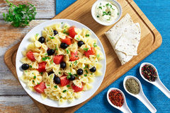 Pasta salad Farfalle with Smoked Salmon, top view Stock Photography