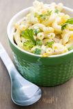 Pasta Salad. A fresh summer pasta salad with elbow macaroni, fresh garden peas, smoky ham and mayo stock photography