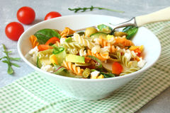 Pasta salad with fresh vegetables, greens, tomatoes, avocado, on Royalty Free Stock Photos