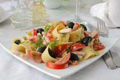 Pasta salad with ham, tomato and olives Royalty Free Stock Images