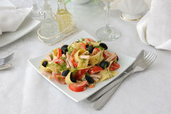 Pasta salad with ham, tomato and olives Royalty Free Stock Photos