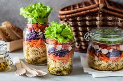Pasta Salad in a Jar. Pasta and Vegetable Salad in a Jar, copy space for your text royalty free stock photography