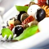 Pasta salad with mozzarella stock images
