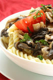 Pasta salad with mushrooms and organic tomato Stock Photo