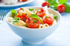 Pasta Salad. With penne, cherry tomatoes and basil stock images