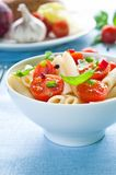 Pasta Salad. With penne, cherry tomatoes and basil royalty free stock photo