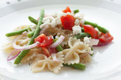 Pasta salad. A plate with pasta salad and vegetables stock image