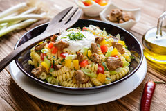 Pasta salad with pork, pepper, green onion, parsley and sour cream Royalty Free Stock Photos