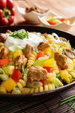 Pasta salad with pork, pepper, green onion, parsley and sour cream Stock Images
