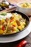 Pasta salad with pork, pepper, green onion, parsley and sour cream Royalty Free Stock Photo