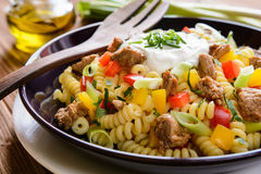 Pasta salad with pork, pepper, green onion, parsley and sour cream Royalty Free Stock Image