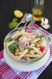 Pasta salad with sea food and spinach. Healthy pasta salad with sea food and spinach Stock Image