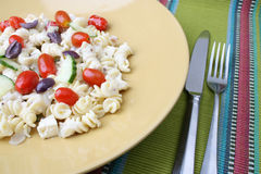 Pasta Salad Setting. Cold Pasta Salad with tomatoes, cucumbers and olives Stock Photos