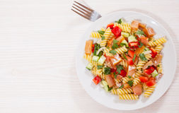 Pasta salad with smoked salmon and vegetables Stock Image