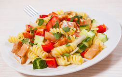 Pasta salad with smoked salmon and vegetables Stock Photo
