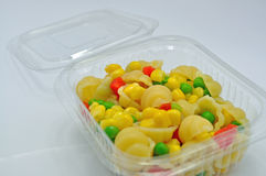 Pasta salad takeaway. Close up of a pasta salad in a takeaway container with lid open Royalty Free Stock Image