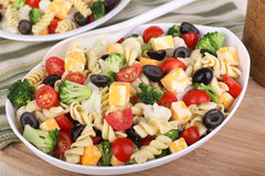 Pasta Salad. With tomato, broccoli, black olives, cauliflower and cheese in a bowl royalty free stock photo