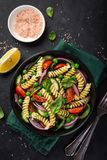 Pasta salad with tomato, cucumber, spinach and grean peas stock photography