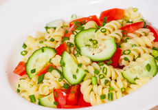 Pasta salad with tomato and cucumber Stock Image