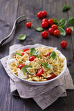 Pasta salad with tomato, mozzarella, pine nuts and basil Stock Images