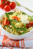 Pasta salad with tomatoes and arugul Royalty Free Stock Images