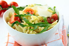Pasta salad with tomatoes and arugula Royalty Free Stock Photo
