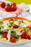 Pasta salad with tomatoes and arugula Stock Photos