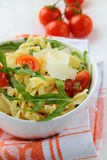 Pasta salad with tomatoes and arugula Stock Image
