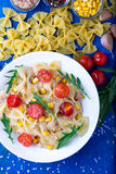 Pasta salad with tomatoes cherry, tuna, corn and arugula. Top view. Pasta salad with tomatoes cherry, tuna, corn and arugula. Top view royalty free stock images