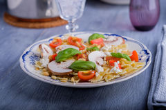 Pasta salad with tomatoes and mushrooms Stock Photos
