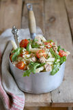 Pasta salad with tuna arugula and cherry tomato Stock Photo