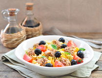 Pasta salad with tuna, cherry tomatoes and olivs Stock Photography