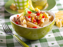 Pasta salad with tuna and corn. In green bowl royalty free stock image