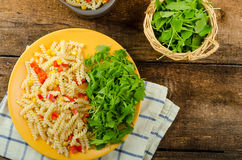 Pasta salad with vegetable and arugula salad with olive oil Stock Photos
