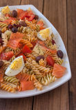 Pasta salad on wooden table Stock Photo