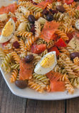 Pasta salad on wooden table Royalty Free Stock Photos
