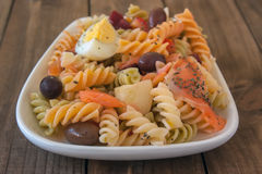 Pasta salad on wooden table Stock Photography