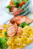 Grilled salmon and pasta dinner Stock Image