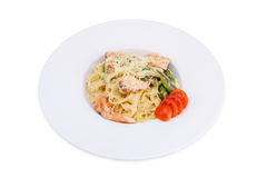 Pasta with salmon. Isolated on white Stock Photo