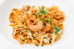 Pasta with salmon and shrimps Stock Images