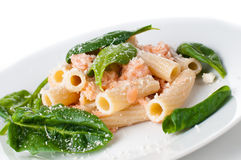Pasta with salmon and spinach Stock Photos