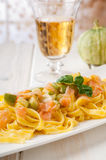 Pasta with salmon and  zucchinis Stock Photo
