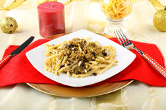Pasta with sardines and fennel on Christmas table Stock Photos